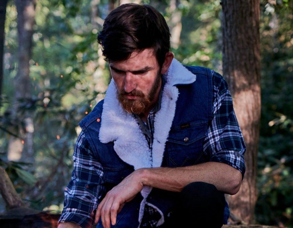 cowboy wearing denim vest