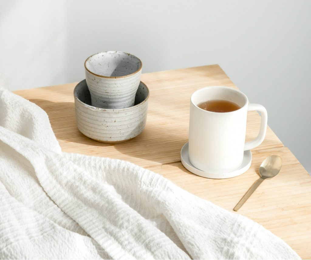 morning warm tea with unique coffee mugs