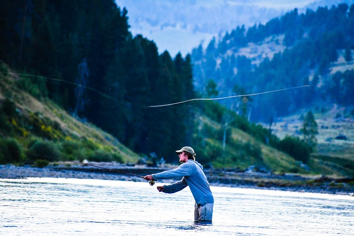 guy fishing while standing in water