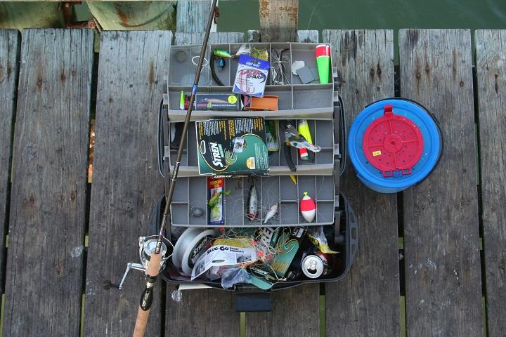 fishing tackle box on wooden bridge