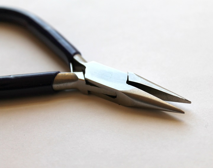 close up picture of needle nose plier
