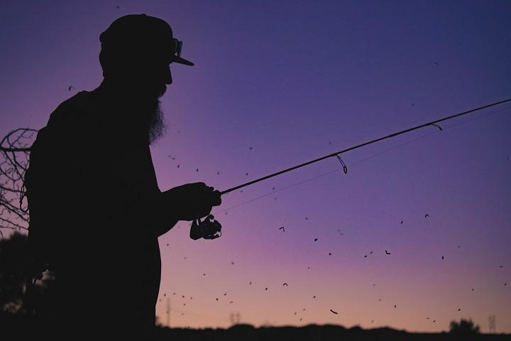guy fishing in sunset