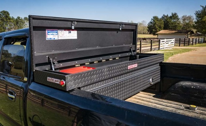 picture of truck with aluminum storage toolbox installed parked on a farm