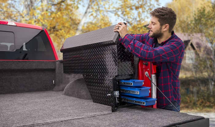picture of a man beside his truck with a side mount aluminum toolbox storage
