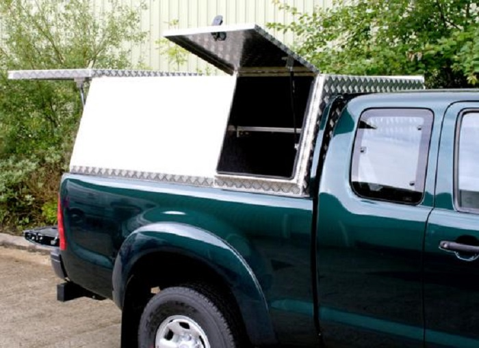 picture of aluminum canopies with side opening doors on a green truck