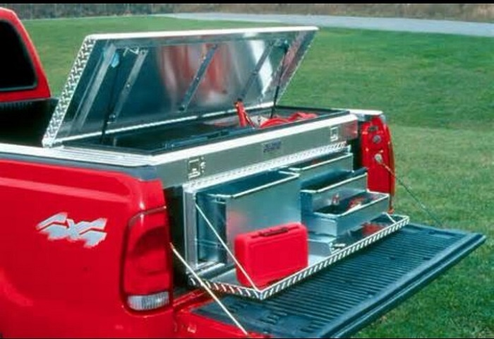 picture of a red truck with aluminum tray storage on the back