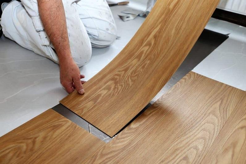 a man installing vinyl tiles