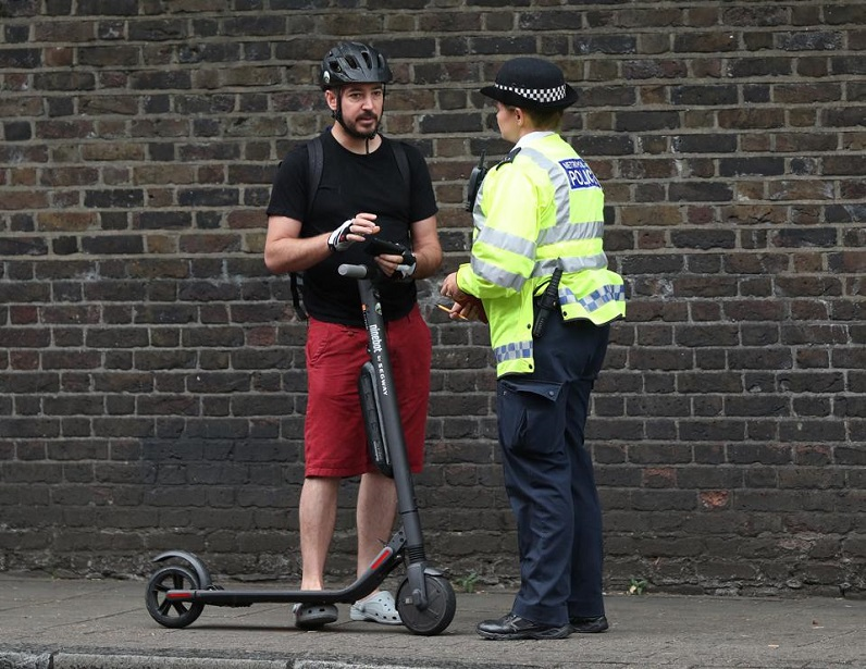 scooter driver stopped by police officer