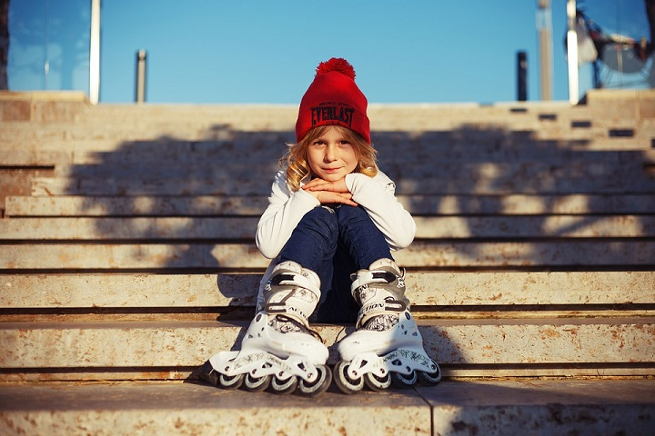 picture of a little girl on a stairs with skates