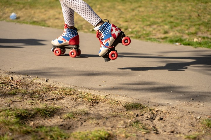 picture of a little girl in a leggings with hearts and roller skates with the American flag