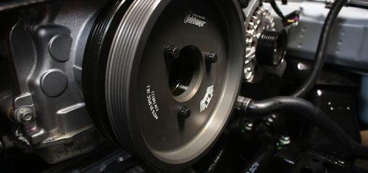 close-up of harmonic balancer attached on engine